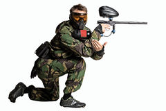 Paintball player in action isolated Royalty Free Stock Images