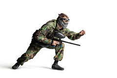 Paintball player in action isolated Stock Image