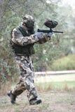 Paintball player aiming the gun Stock Photos