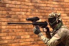 Paintball player aiming the gun Stock Photo