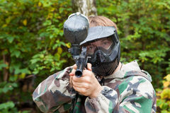 Paintball player is aiming, looking in the face Stock Images