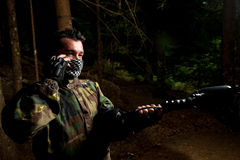 Paintball player calling someone at the phone Royalty Free Stock Photography