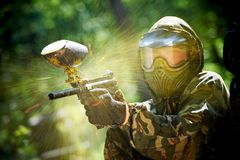 Paintball player direct hit Royalty Free Stock Photos