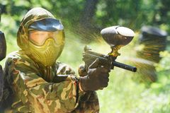 Paintball player direct hit Stock Photo