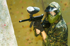 Paintball player firing Stock Photo