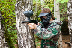 Paintball player in the forest Royalty Free Stock Image