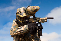 Paintball player with gun royalty free stock photos