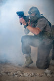 Paintball player with gun Royalty Free Stock Images