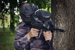 Paintball player. Hidding in the forest Royalty Free Stock Photos