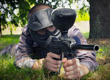 Paintball player. Hidding in the forest Royalty Free Stock Image
