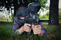 Paintball player. Hidding in the forest Royalty Free Stock Photo