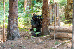 Paintball Player Hide Behind Tree Stock Photo