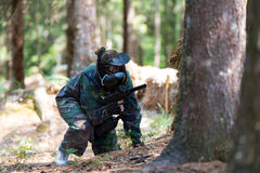 Paintball Player Hide Behind Tree Royalty Free Stock Image