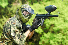 Paintball player holding fire Royalty Free Stock Images