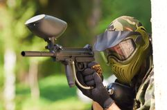 Paintball player holding fire Royalty Free Stock Photos