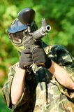 Paintball player holding fire Royalty Free Stock Image