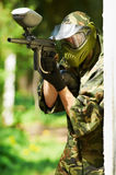 Paintball player holding fire Stock Photography