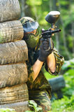 Paintball player holding fire Stock Image