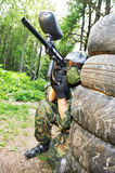Paintball player holding position Stock Image