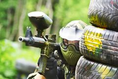 Paintball player holding position stock photos