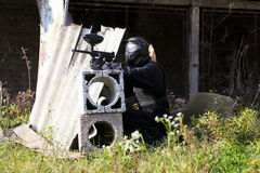 Paintball player holding position Royalty Free Stock Images