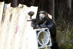Paintball player holding position Stock Images