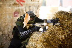 Paintball player holding position Stock Photography