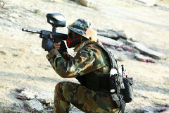 Paintball player holding position Royalty Free Stock Photos