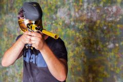Free Paintball Player In T-shirt Shooting Target With Gun Royalty Free Stock Photos - 123380438
