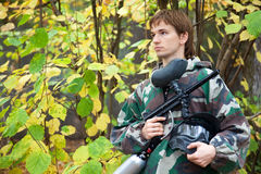 Paintball player looks aside Stock Image