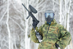 Paintball player with marker at Stock Photography