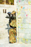 Paintball player with marker at winter outdoors Stock Photo
