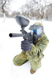 Paintball player with marker at winter outdoors Stock Images