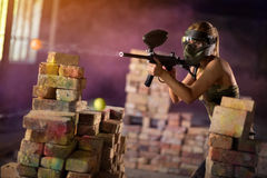 Paintball player in mid game Stock Image