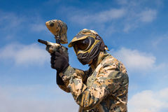 Paintball player over sky background Royalty Free Stock Photography