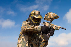 Paintball player over sky background Stock Photography