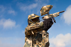 Paintball player over sky background Stock Photos