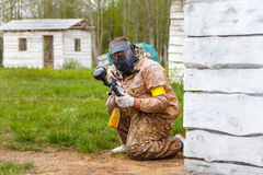 Paintball player with paint gun Royalty Free Stock Photo