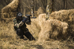 Paintball player shooting Stock Images