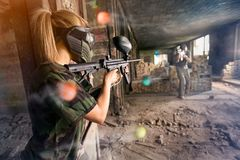 Paintball player shooting in opposite  player. Paintball player shooting in opposite  player, leisure game stock photo