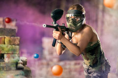 Paintball player shootout Stock Image