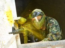 Paintball player under attack Royalty Free Stock Photography