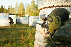 Paintball player under attack Stock Images