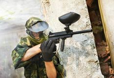 Paintball player under cover Royalty Free Stock Image