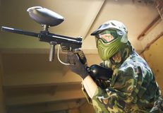 Paintball player under cover Stock Photography