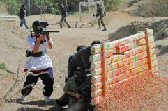 Paintball Players behind Bunker Stock Images