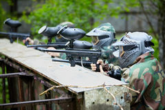 Paintball players in camouflage aims the enemies Stock Images