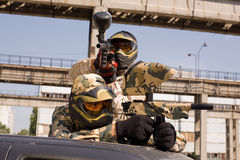 Paintball players on the car. Two paintball players on the car royalty free stock photography