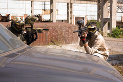 Paintball players on the car Royalty Free Stock Images