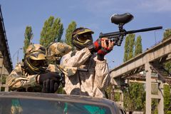 Paintball players on the car Stock Photos
